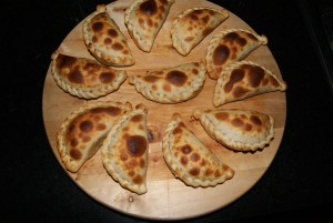 Empanadas, Argentinian hand pies filled with meats, cheeses, veggies, and baked or fried.